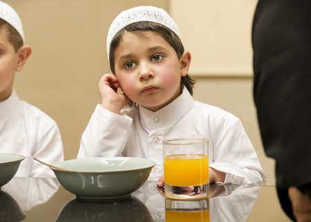 poor: Arabian Kid having his breakfast