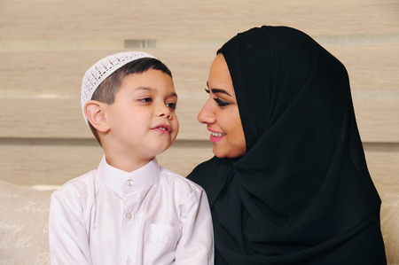 smiling mother: Arabian Family, Mother and son at home Stock Photo