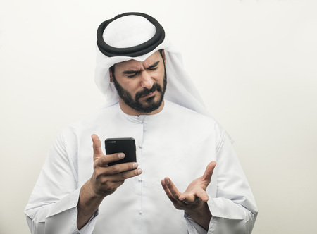 social emotional: Angry Arabian Businessman, Arabian Businessman expressing anger on the phone Stock Photo