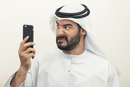 phonecall: Angry Arabian Businessman, Arabian Businessman expressing anger on the phone Stock Photo