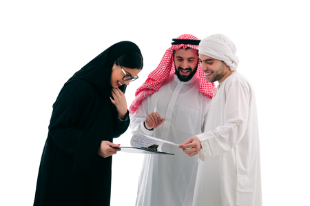 abudhabi: Arabian business Team in a meeting, three business people standing over a white background, ethnic business people, business team, success concept Stock Photo
