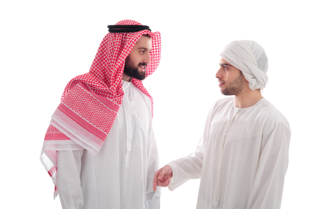 abudhabi: Two Young Arabian Businessmen discussing work over a white background, business concept