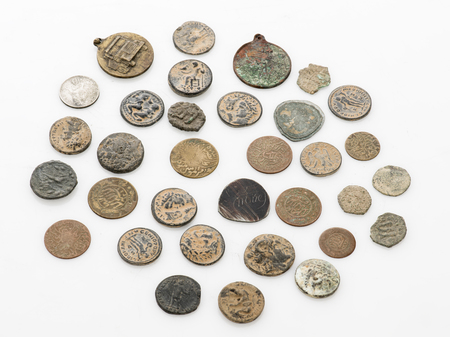 Collection of old vintage coins isolated on white