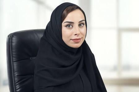 Young Arabian businesswoman in office