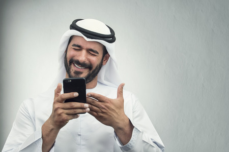 Arabian Businessman smiling on the phone