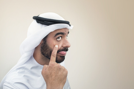 maldestro: Arabian man doing a funny expression , Clumsy expression of an Arabian businessman   Archivio Fotografico