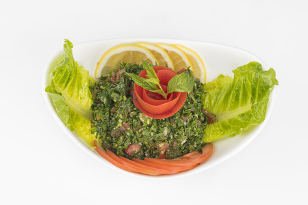 Plate of traditional Arabic salad tabbouleh   Stock Photo