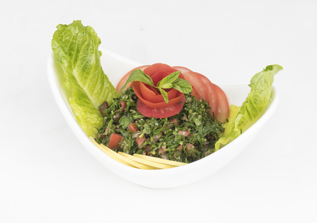 Plate of traditional Arabic salad tabbouleh   Imagens