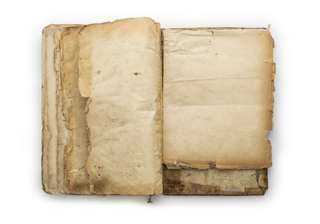 Old opened book isolated on a white background Imagens