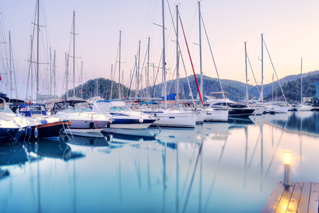 Yachts parking in harbor at sunset, Harbor yacht club in Gocek, Turkey