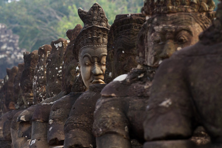 13th century: Locate on Siem Reab , Cambodia An ancient city built in the late 12th or early 13th century as the official state temple of the Mahayana Buddhist King Jayavarman VII, the Bayon stands at the centre of Jayavarman Stock Photo