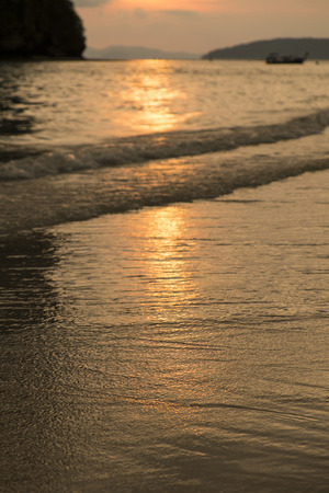 aonang: Sunset reflect on the beach at Ao-nang beach Krabi province Stock Photo