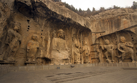 Luoyang, Henan, China19 MAR 2014Chinese Buddhist art  were carved into caves excavated from the limestone cliffs of the Xiangshan and Longmenshan mountains
