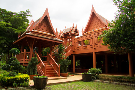 Thai traditional style house with a new material such as reinforce concrete