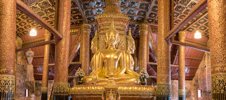 turn back: Nan province, Thailand : 7 Jan 2015 - The golden Buddha image in temple of Wat Phumin is a unique, there are four buddha turn back together, Editorial