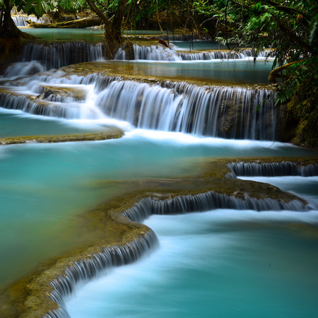 waterfall in the forest: Kuang Si Waterfall is a huge waterfall in deep tropical forest near Luang prabang, Laos Stock Photo