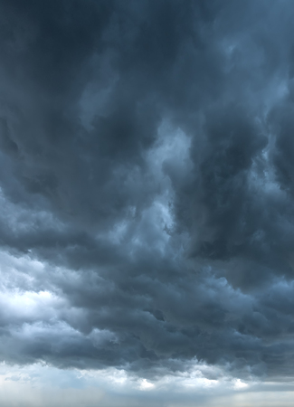 A sky background with dark clouds of storm in rainy season.