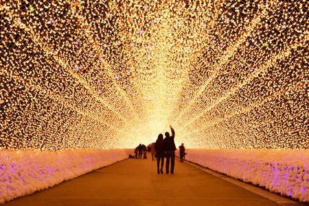 Mie, Japan - March 4, 2015: unidentified tourist walk through light tunnel in Nabana no sato winter illumination ,Mie province. This is one of Japan's largest illumination parks.