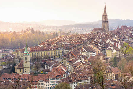 munster: A cityscape of Bern, medival city in Switzerland in the early morning with a soft fog.