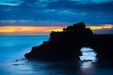 Silhouette scene of  Pura Tanah lot after sunset , Hindu temple that is one of the most favourite dramatic sunsets scene of Bali.