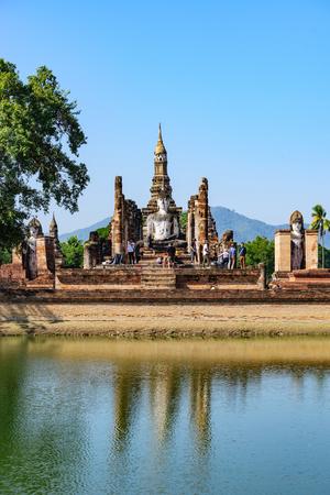 Sukhothai, Thailand - DEC 31, 2016 : Buddha statue and pagoda of wat Mahathat in Sukhothai historical park, world heritage site in Thailand. Stock Photo