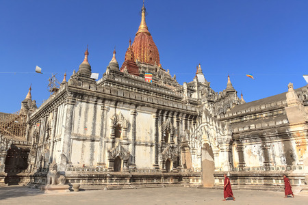 Bagan, Myanmar - JAN 24, 2013 : The monks walk infront of Ananda pagoda, one of the most beautiful temple of bagan.