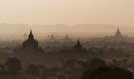 sight seeing: Silhouettes of old temples before sunrise in Bagan, Myanmar