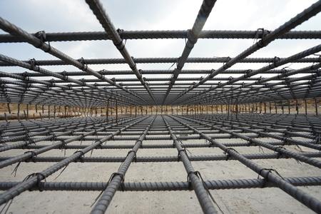 A deformed steel bars frame inside concrete footing or floor.