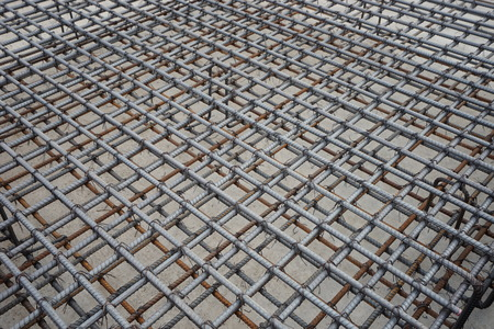 A deformed steel bars frame inside concrete footing or floor.
