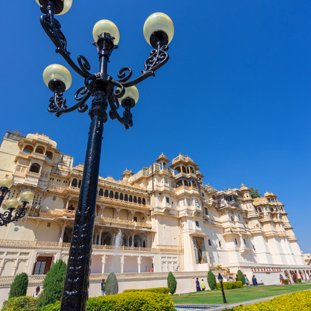 UDAIPUR, RAJASTHAN, INDIA- FEB 24, 2018 : The city palace, a view from inner court in front of the building in the sunny day with blue sky.