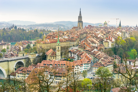 A cityscape of Bern, medival city in Switzerland in the early morning with a soft fog.