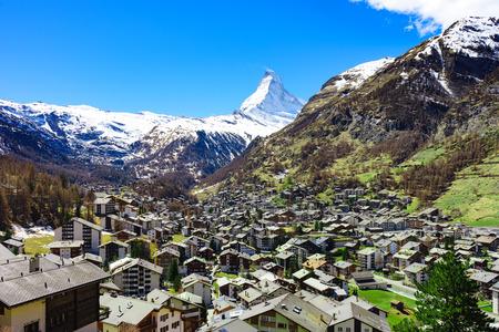Aerial View on Zermatt village and Matterhorn Peak in background, Switzerland Stock Photo