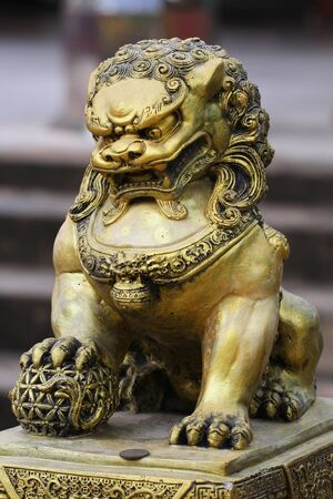 path to wealth: golden dragon horse statue in chinese temple