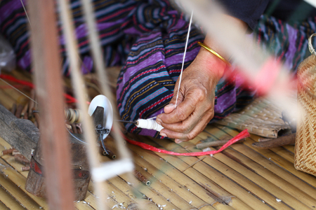 Thai traditional lady weaving knitting work, women activity picture, upcountry lifestyle at village east of Thailand, home made textile business