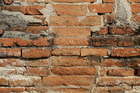 Stone brick Wall in the middle of clay, layered stack decoration, sunlight outdoor retro style, backgrounds, wallpaper Stock Photo