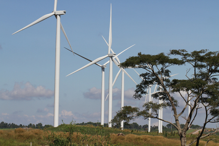 wind turbine on clear blue sky, Renewable electricity Energy, sustainable conservation power development concept on green field, environment friendly background, wallpaper