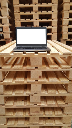 One white laptop monitor screen for warehouse staff on stacking wooden pallet, working condition, decoration, wallpaper, backgrounds Banco de Imagens
