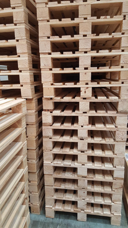 well organize stacking new condition of brown wooden pallets for product distribution and transportation in warehouse