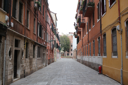 Walking path on stone road surround by ancient medival building in Venice, Italy, Tourist visiting, sightseeing, commercial advertisement backgrounds for graphic designer