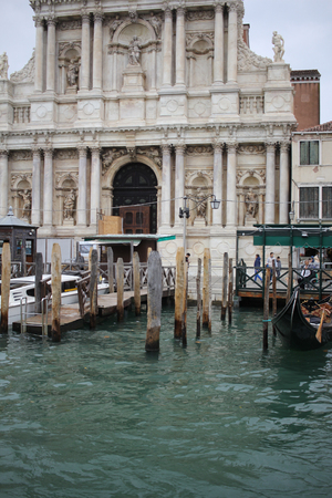 Ancient building surround with water in Venice on the canal, lifestyle in Italy, boat trip in Venezia, commercial advertisement