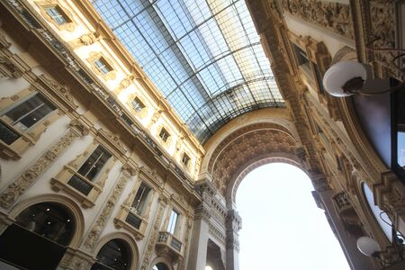 Marvellous interior decoration design of The Galleria Vittorio Emanuele II in Milan, Italy, The oldest shopping mall of Milan. The shopping mall was named after Victor Emmanuel II, first king of Italy. travel destination backgrounds Imagens