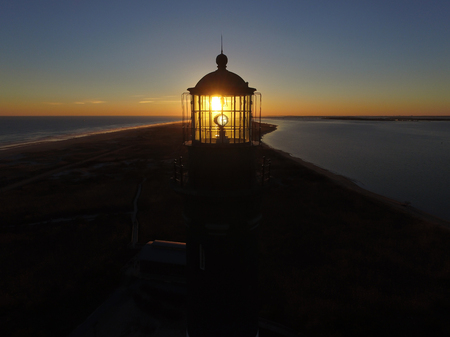 A Yellow Sunrise Shining Thru the Glass of a Lighthouse Light
