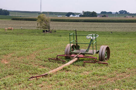Amish Farm with Old Farm Equipment sitting in the Field on a Autumn Day 4 Reklamní fotografie