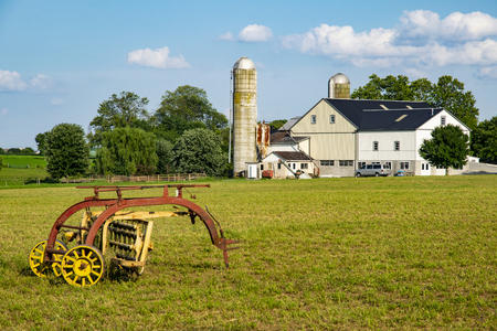 Amish Harvesting Equipment in the Field on an Autumn Day