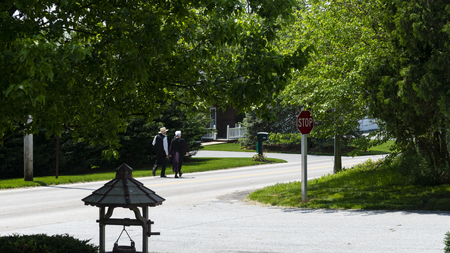 Amish Couple Walking down the Road on a Sunny Day