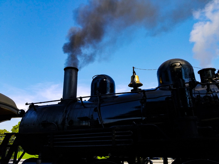 Steam Locomotive Warming up a Train Station on a summer Day