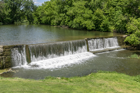 Amish Countryside with a Man Made Waterfall by a Mill Standard-Bild