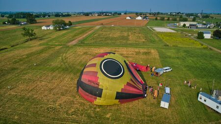 Aerial View of Hot Air Balloons Trying to Launch in a Wind as Seen by a Drone