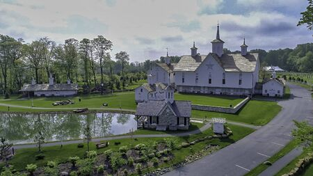 Aerial View of a Old Barns with Steeple or Cupola as Seen by a Drone