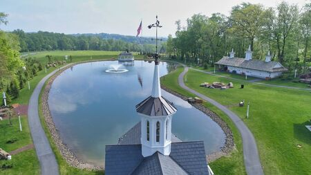 Aerial View of a Steeple or Cupola and Pond as Seen by a Drone